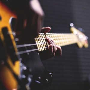 electric bass lessons adamsmusic.com