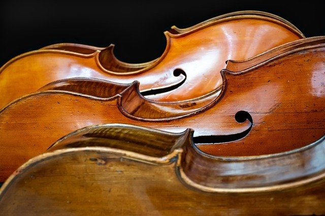 cello, viola, and violin on their side