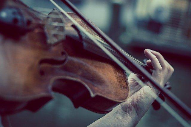 closeup of violin player's hands