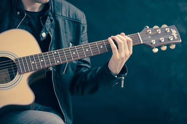 Man playing guitar Music Lesson Practice